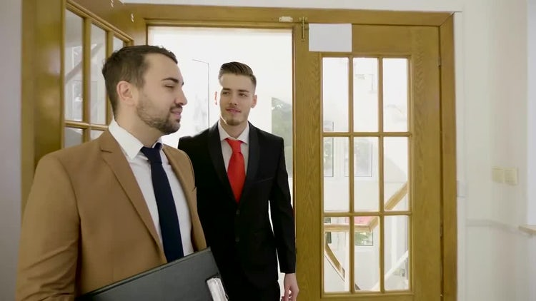 Two Businessmen Entering The Office: Stock Video