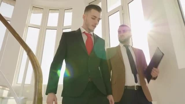 Businessmen Going Down Office Stairs : Stock Video