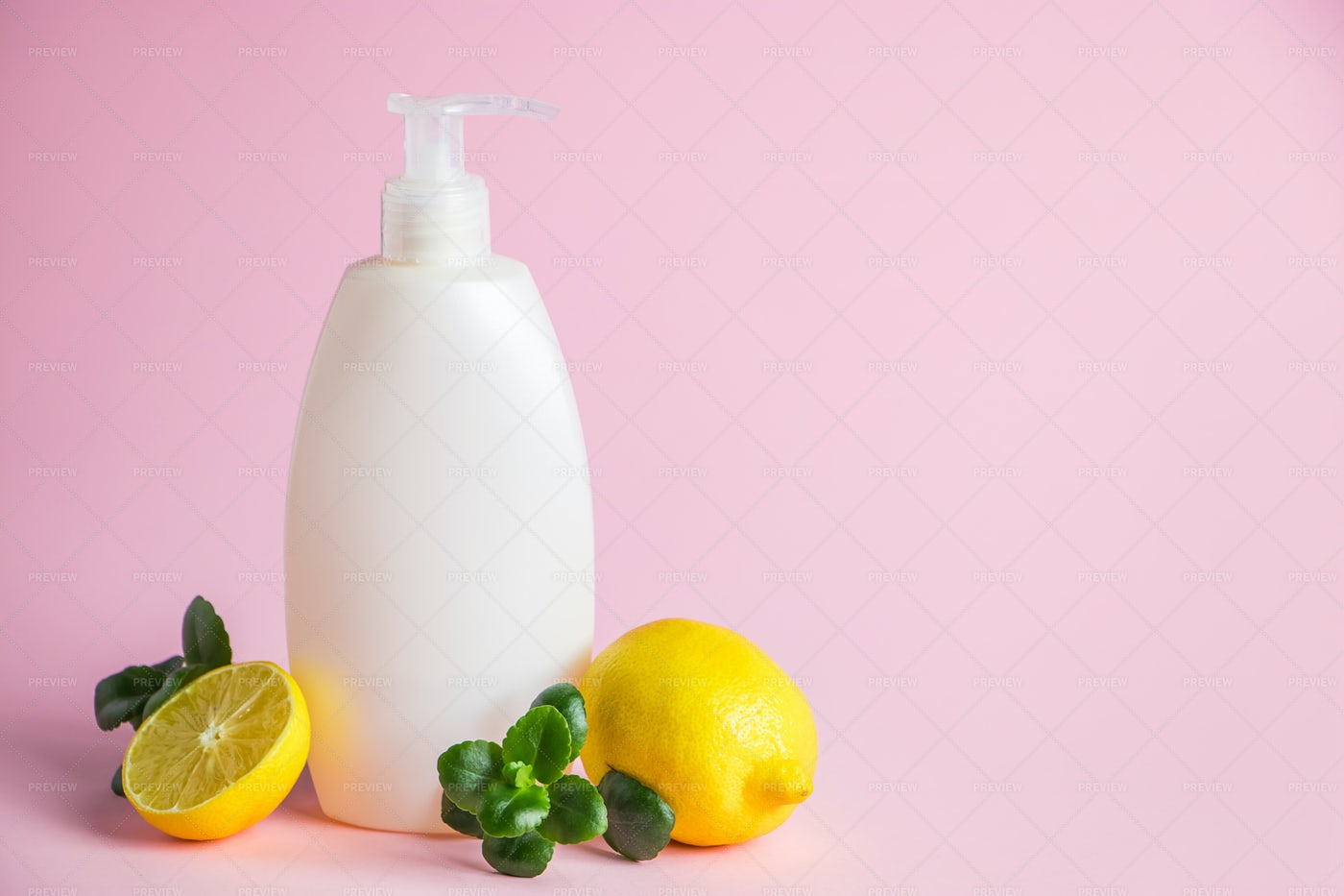 A Bottle Of Lemon Cosmetic Oil: Stock Photos