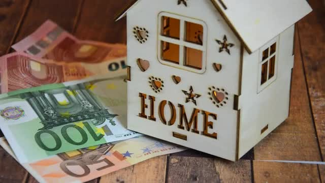 Wooden House And Currency Notes: Stock Video