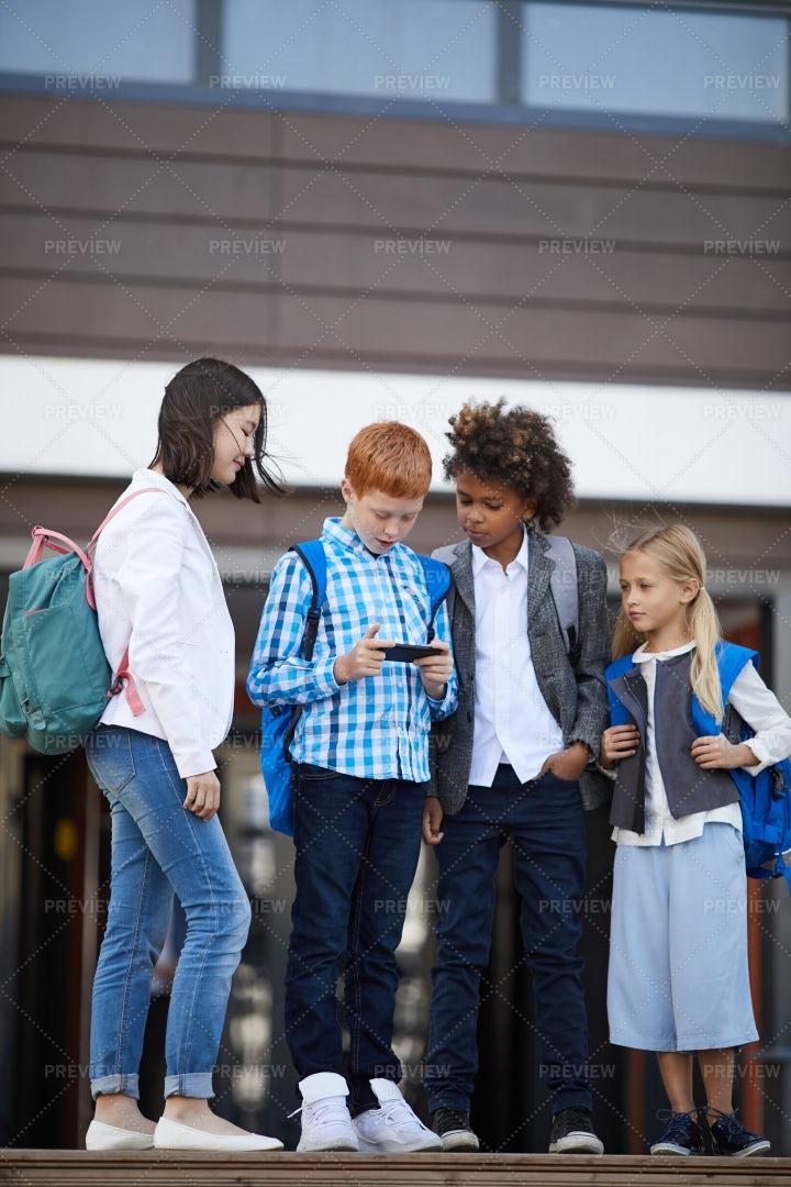 School Children Using Phone: Stock Photos
