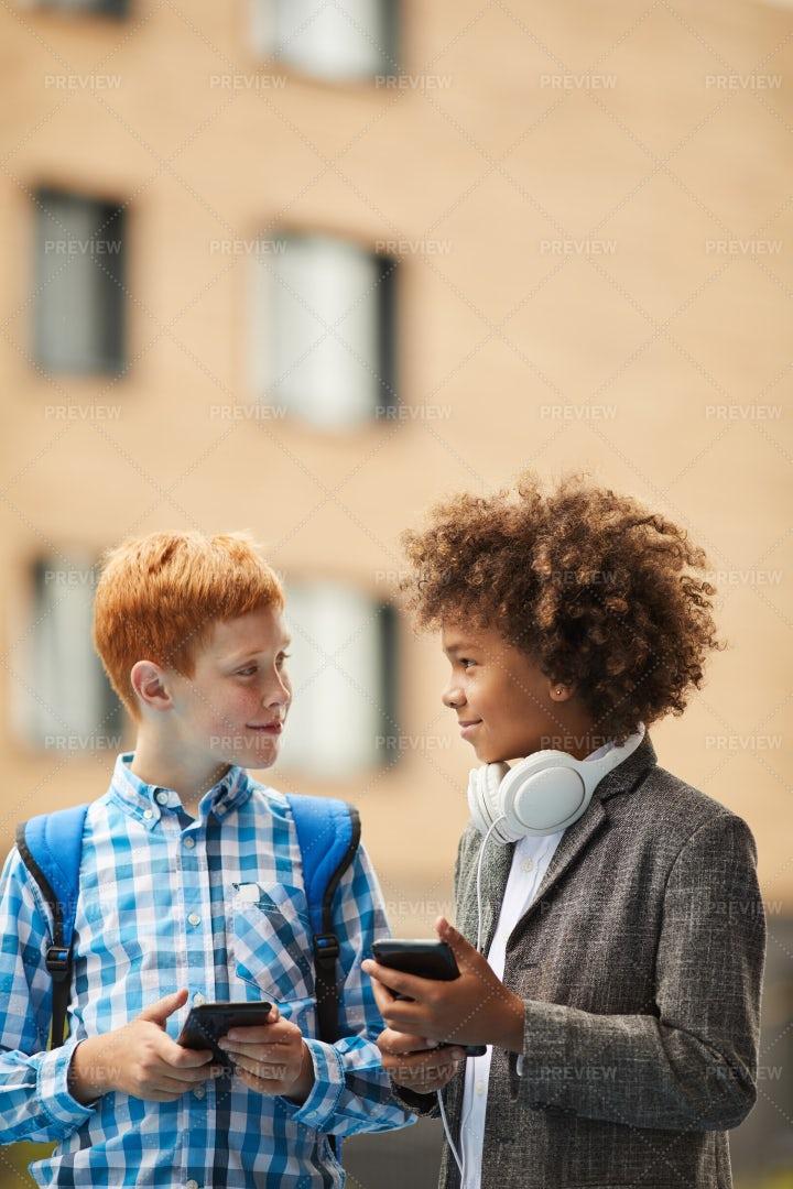 Schoolboys Using Smartphones: Stock Photos