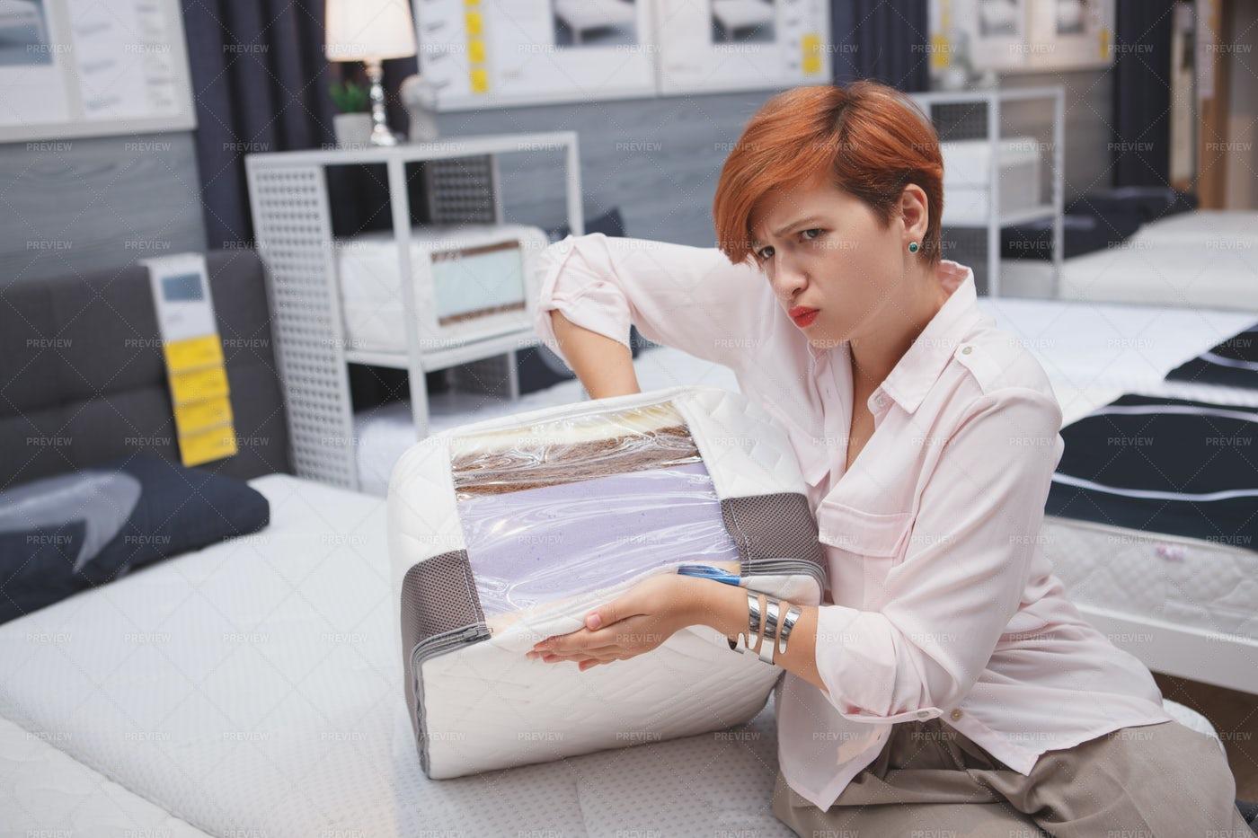Woman Squeezing Mattress: Stock Photos