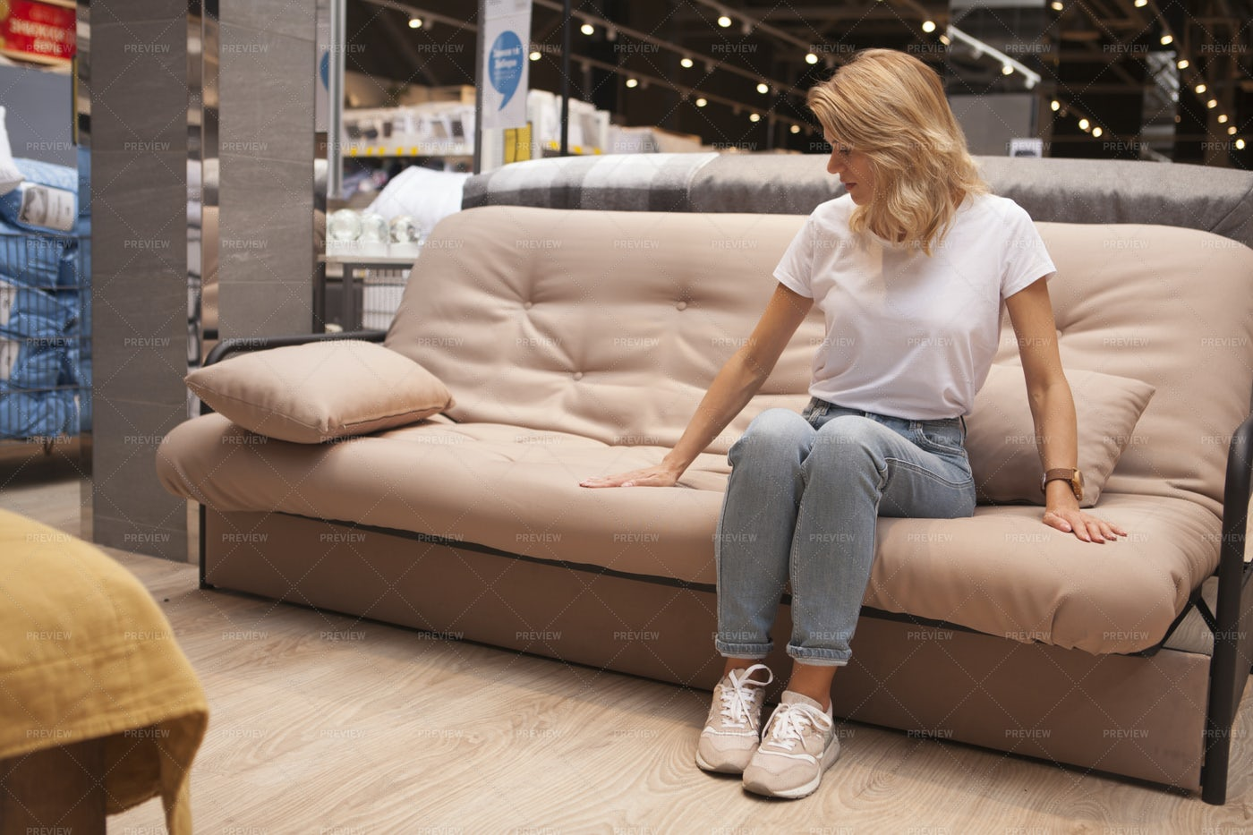 Customer Sitting On A Couch: Stock Photos