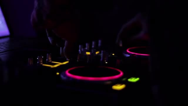 DJ On Decks Mixing Music: Stock Video