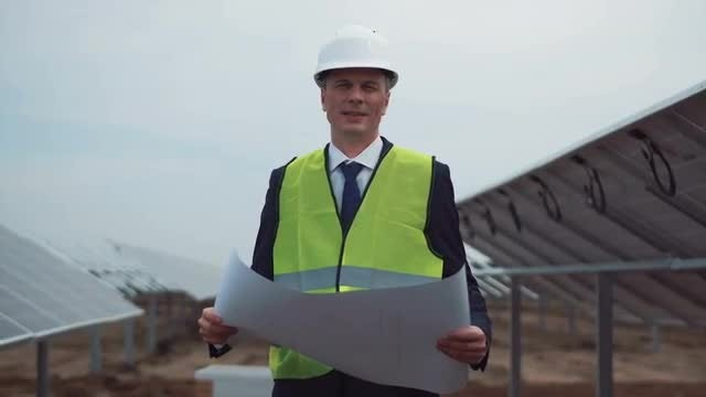 Engineer With Solar Plant Blueprint: Stock Video