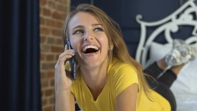 Happy Girl Talking On Cellphone : Stock Video