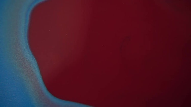 Red Paint Poured Into Blue Paint: Stock Video