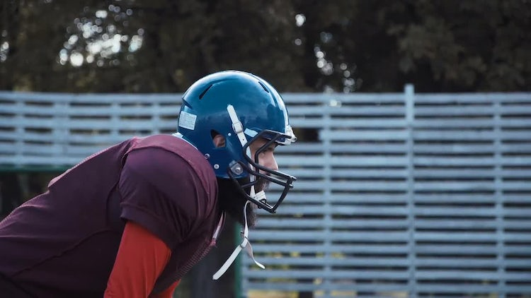 Footballer Putting On Protective Gear: Stock Video
