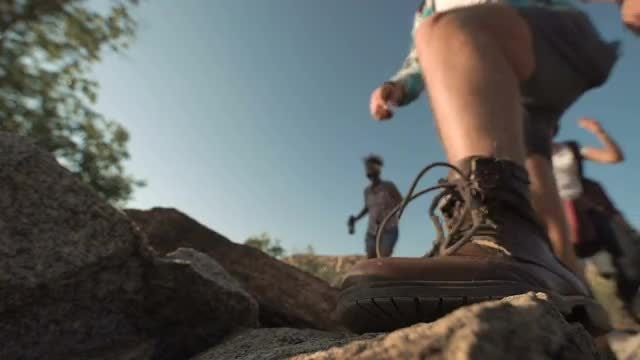 Trekkers Passing By In Rocks: Stock Video