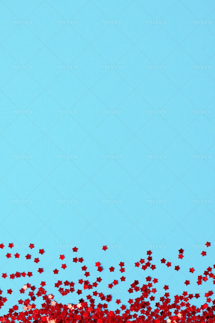 Red Confetti On Blue: Stock Photos