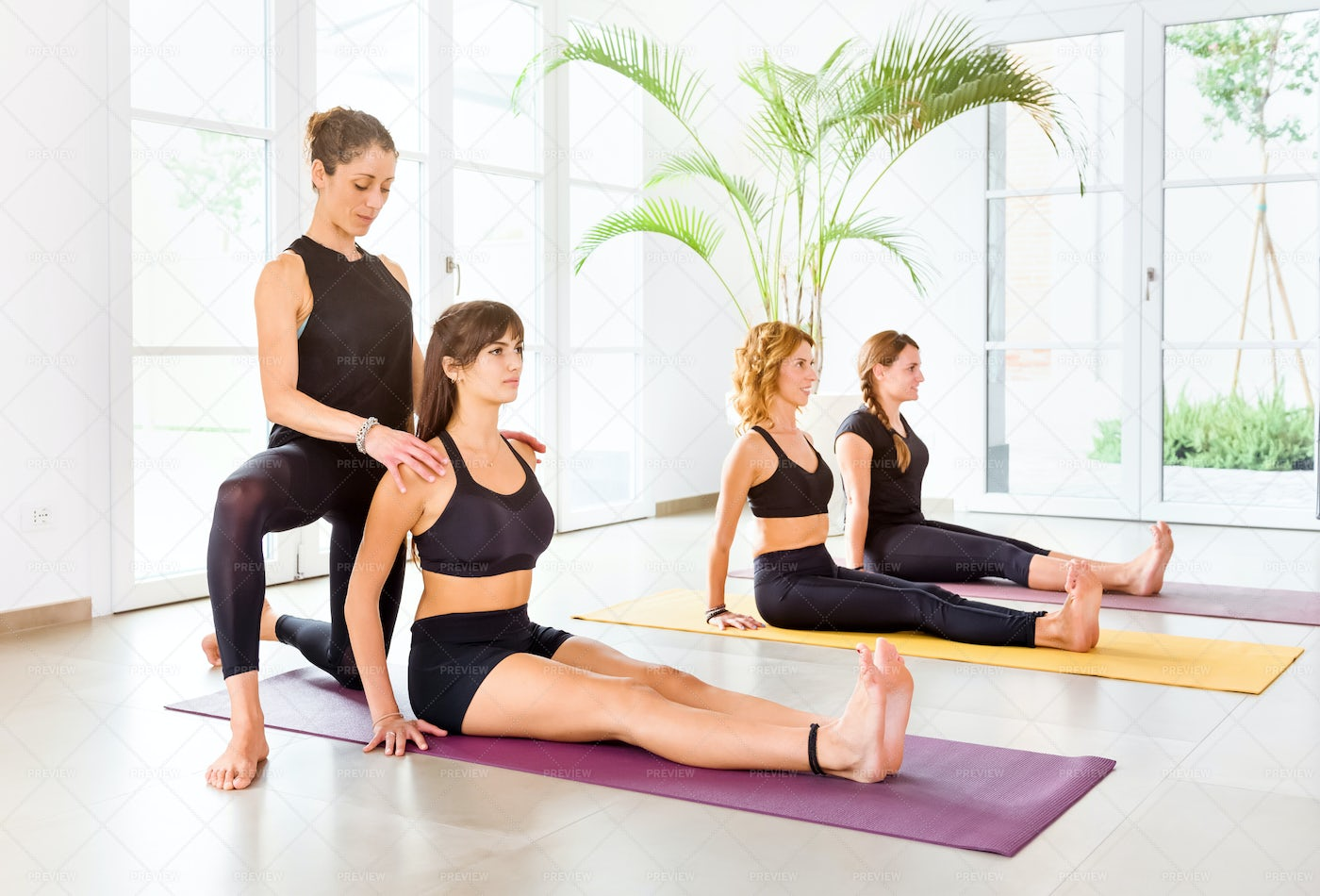 A Yoga Instructor Assists: Stock Photos