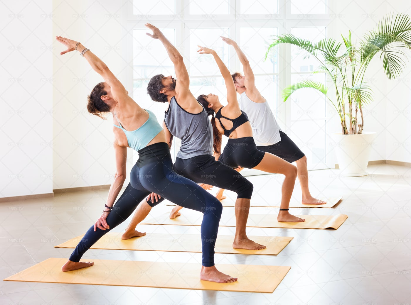 Yoga Class Pracitcing Poses: Stock Photos