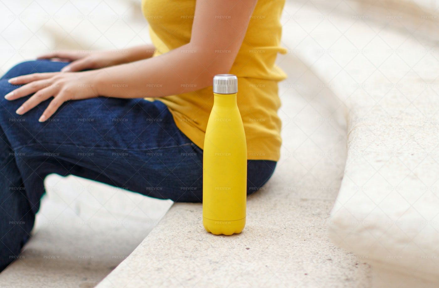 Young Woman Sits Near Bottle: Stock Photos