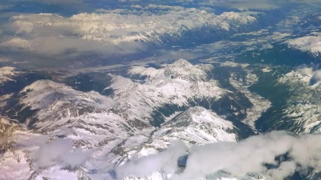 Aerial View Of Snow Capped Mountains: Stock Video