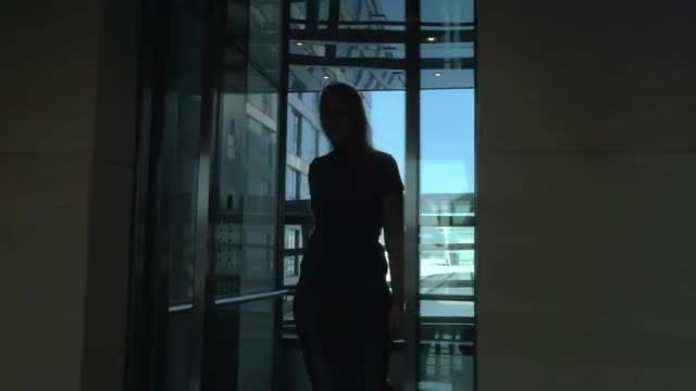 Woman Stepping Off Hotel Elevator: Stock Video