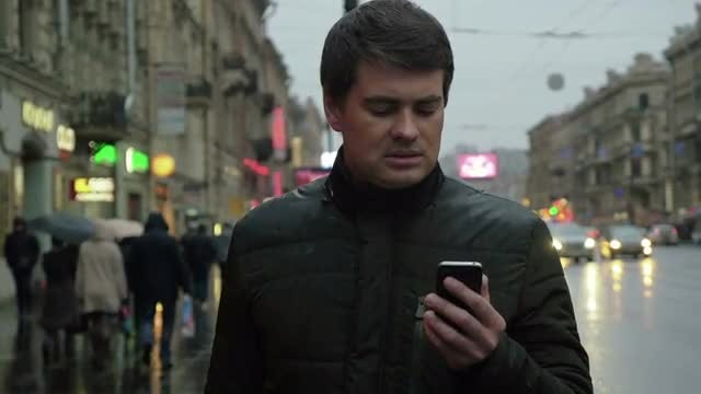 Man Using Smartphone Outdoors: Stock Video