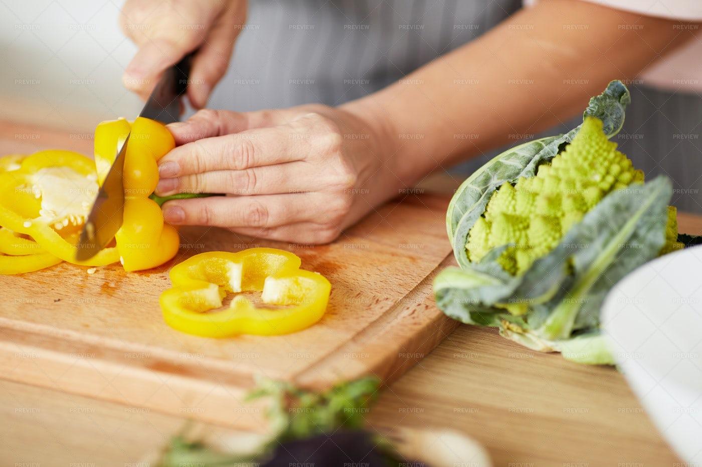 Woman Cutting Pepper: Stock Photos