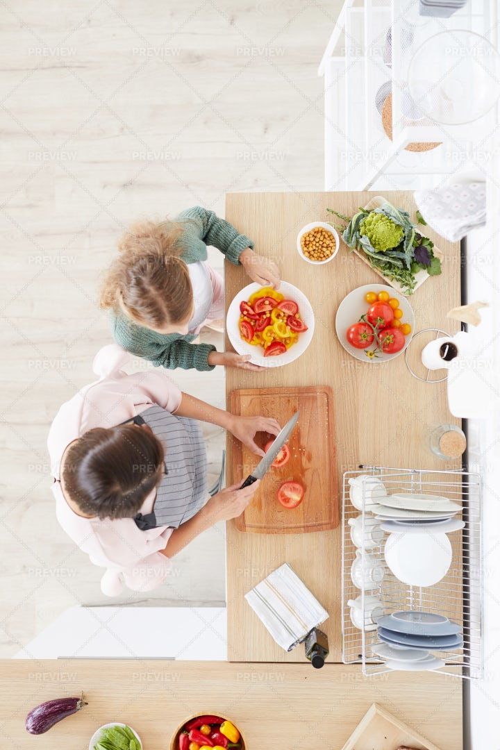 Mother Cooking With Her Daughter: Stock Photos