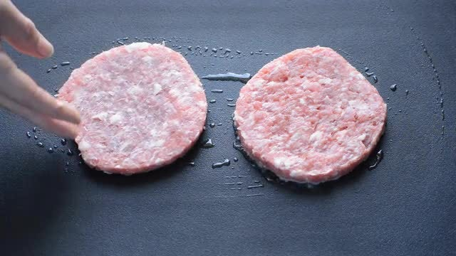 Frying Two Burger Patties: Stock Video