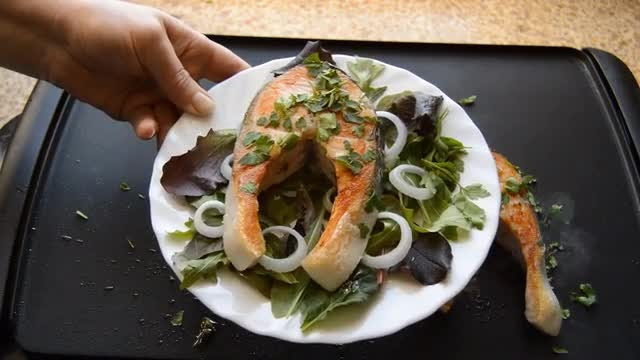 Serving Fried Salmon With Vegetables : Stock Video
