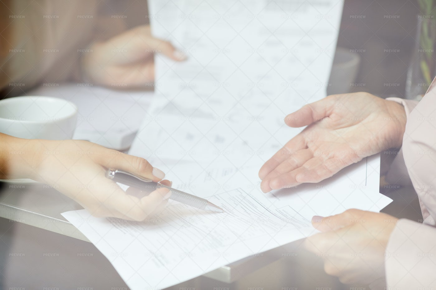 Business People Discussing Contract: Stock Photos