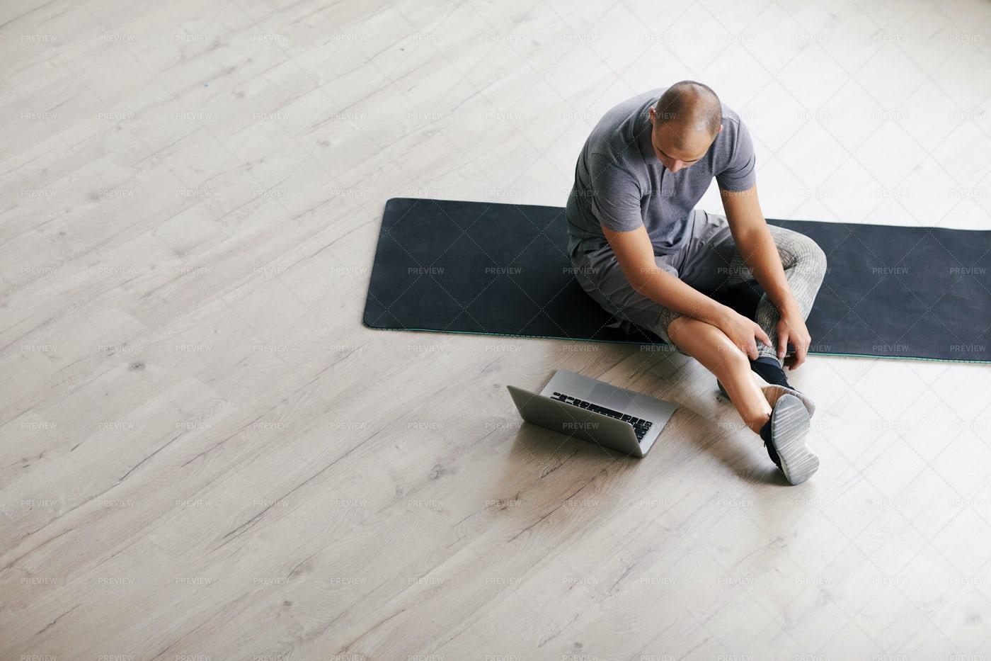 Exercising Beside His Laptop: Stock Photos
