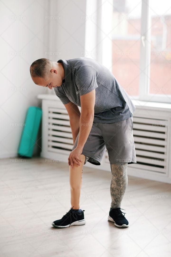 Fastening His Prosthesis Leg: Stock Photos
