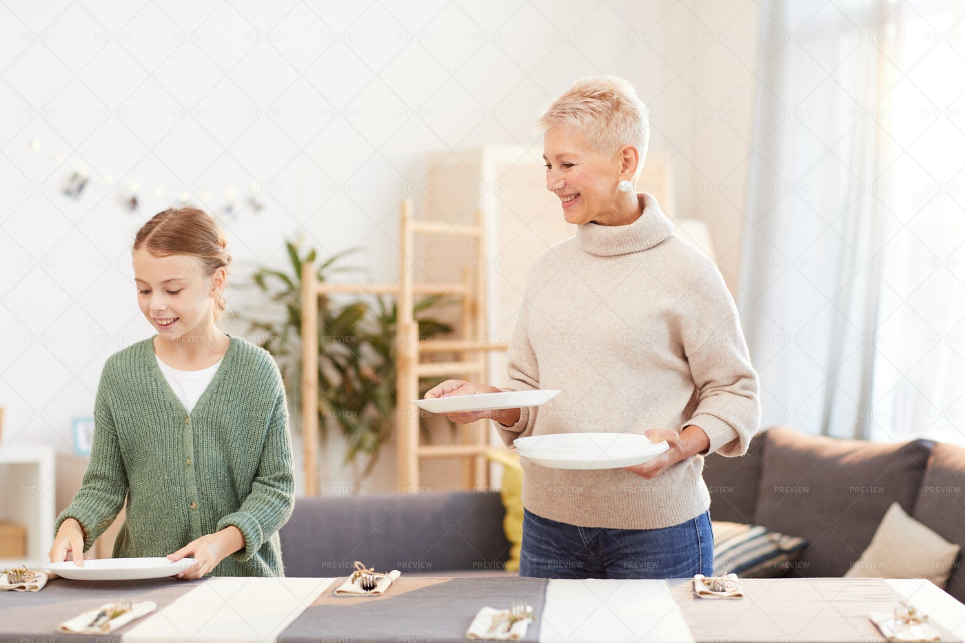 Mother And Daughter Prepre The Table: Stock Photos