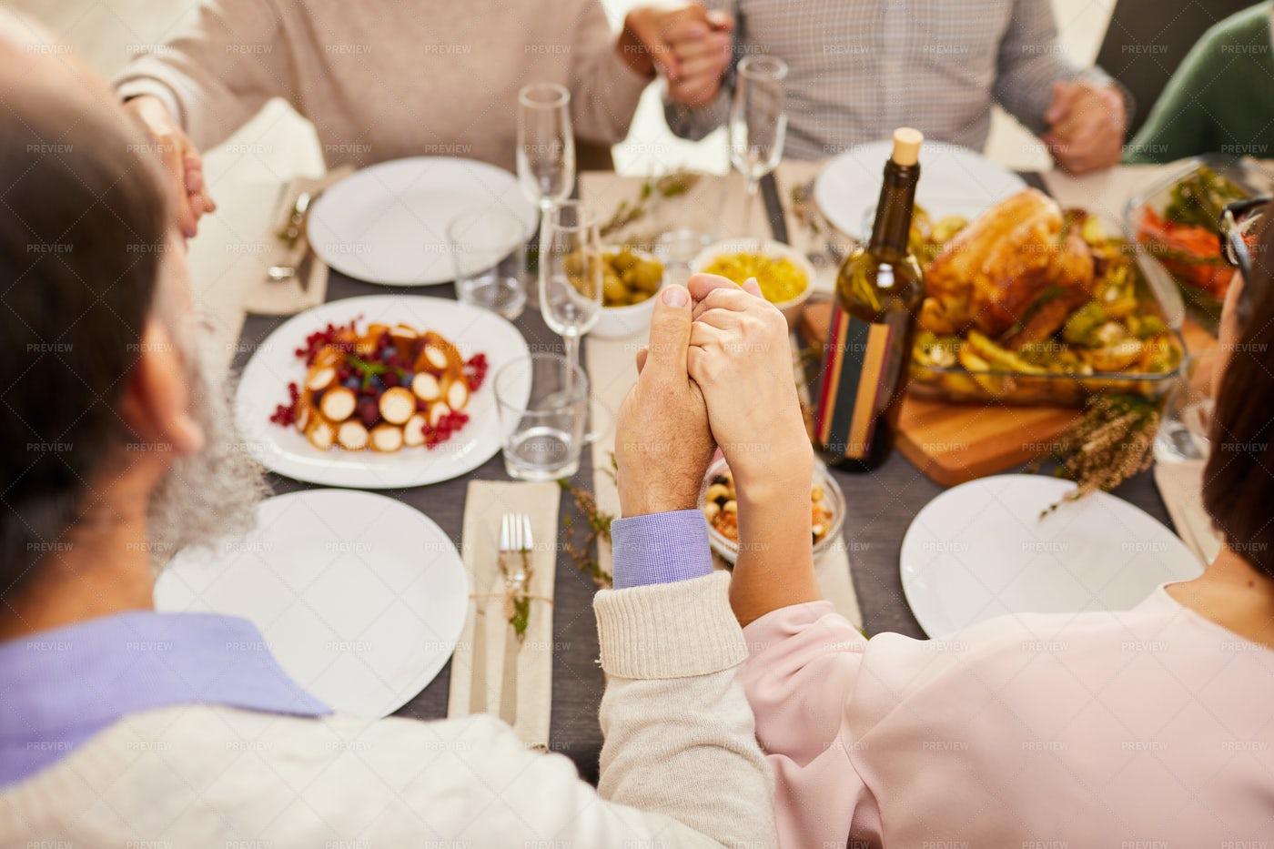 Family Praying During Dinner: Stock Photos