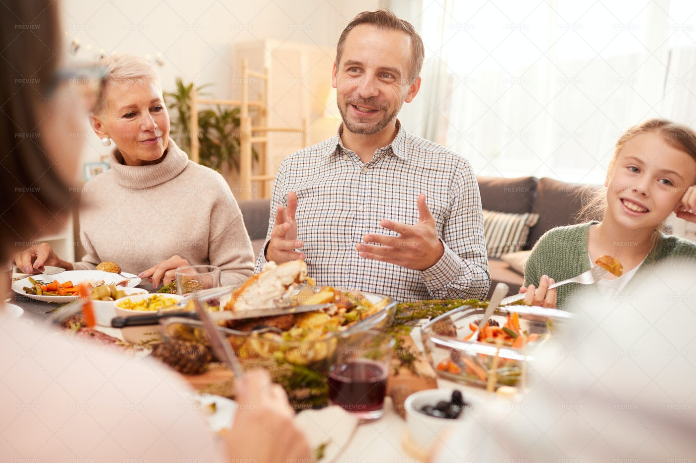 Joyful Family Having Dinner: Stock Photos