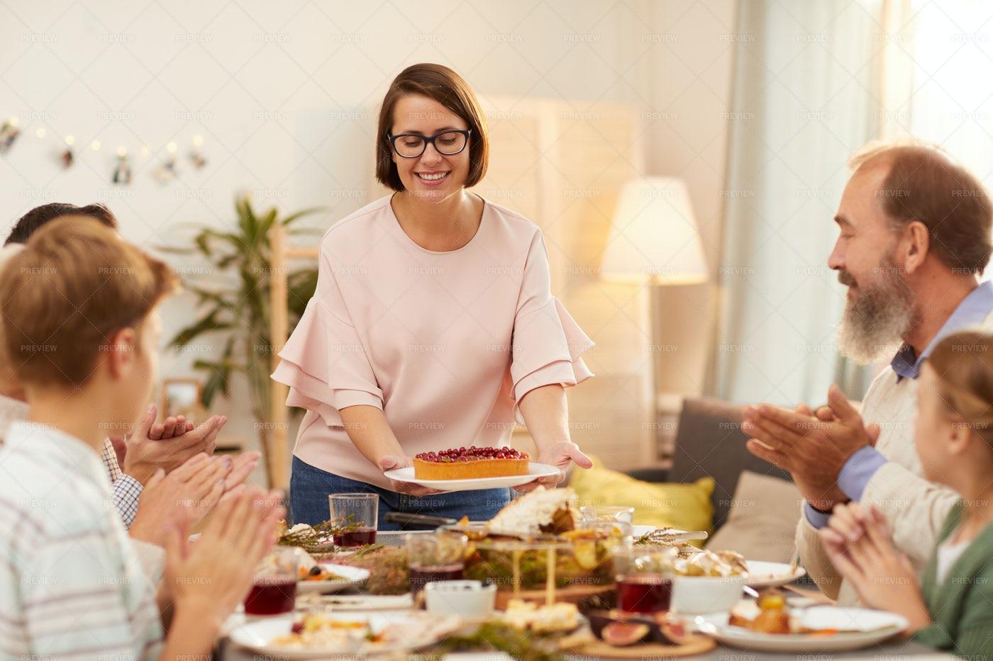 Woman Bringing Cake: Stock Photos
