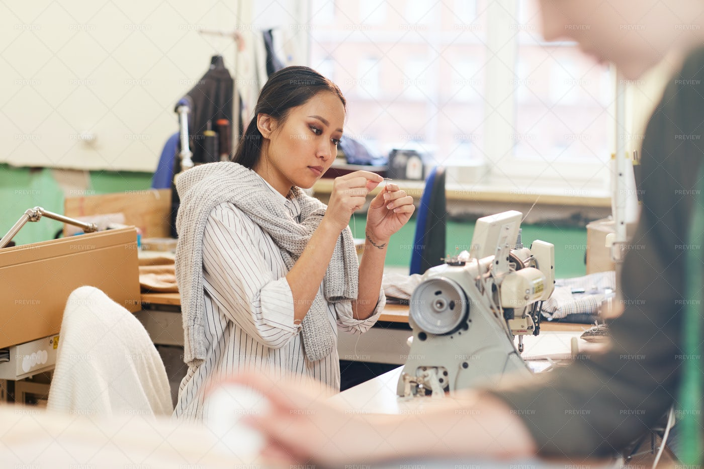 Woman Sewing With Needle: Stock Photos