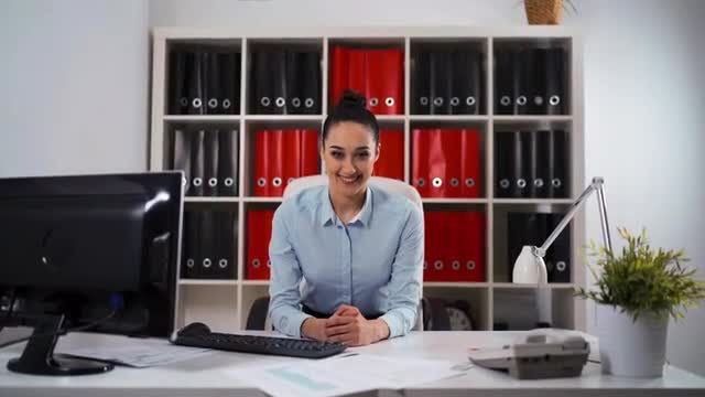 Portrait Of Businesswoman In Office: Stock Video