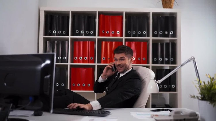 Young Businessman Talking On Phone: Stock Video