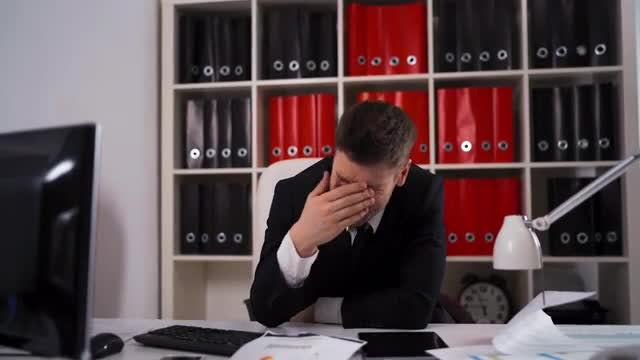 Businessman Falling Asleep In Office: Stock Video