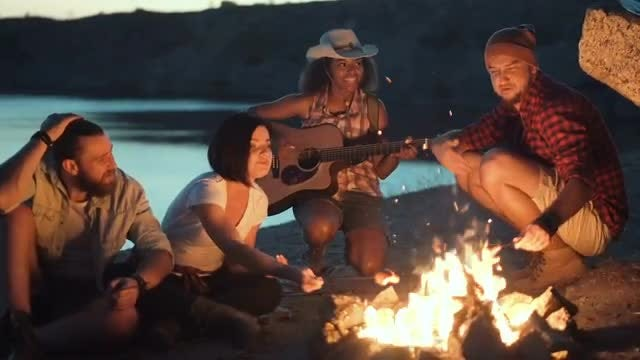 Travelers Relaxing Around Campfire: Stock Video