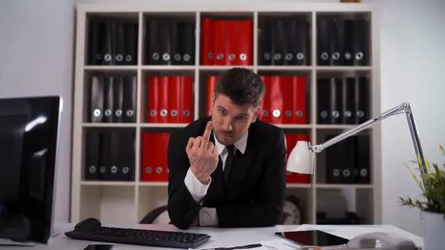 Young Businessman Flips The Bird: Stock Video