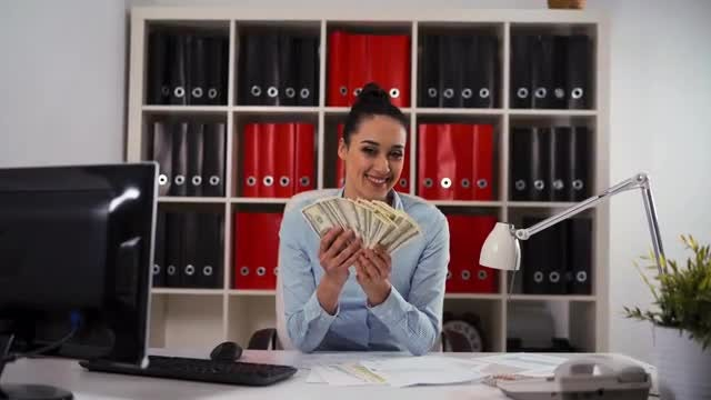 Businesswoman Happily Counting Dollar Bills: Stock Video
