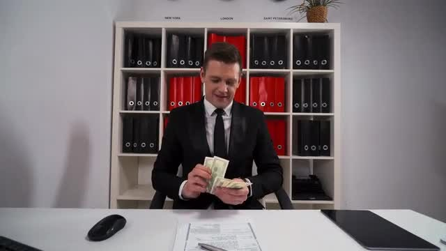 Businessman Counting Dollar Bills: Stock Video