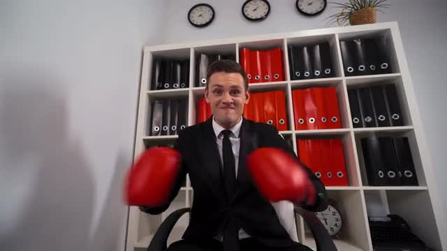 Businessman With Boxing Gloves Threatening: Stock Video