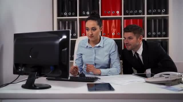 Employees Working On Desktop Computer: Stock Video