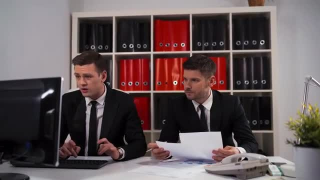 Male Employees In The Office: Stock Video