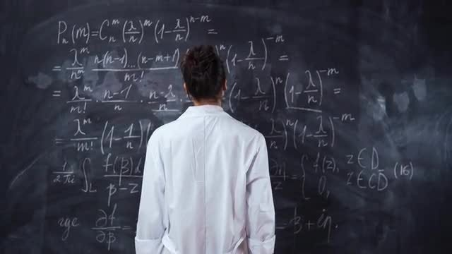 Solving Equations On Chalk Board: Stock Video