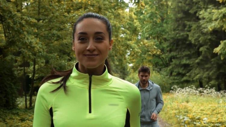 Jogging Woman Looks Back: Stock Video