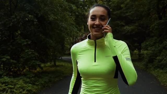 Jogging And Speaking On Smartphone: Stock Video