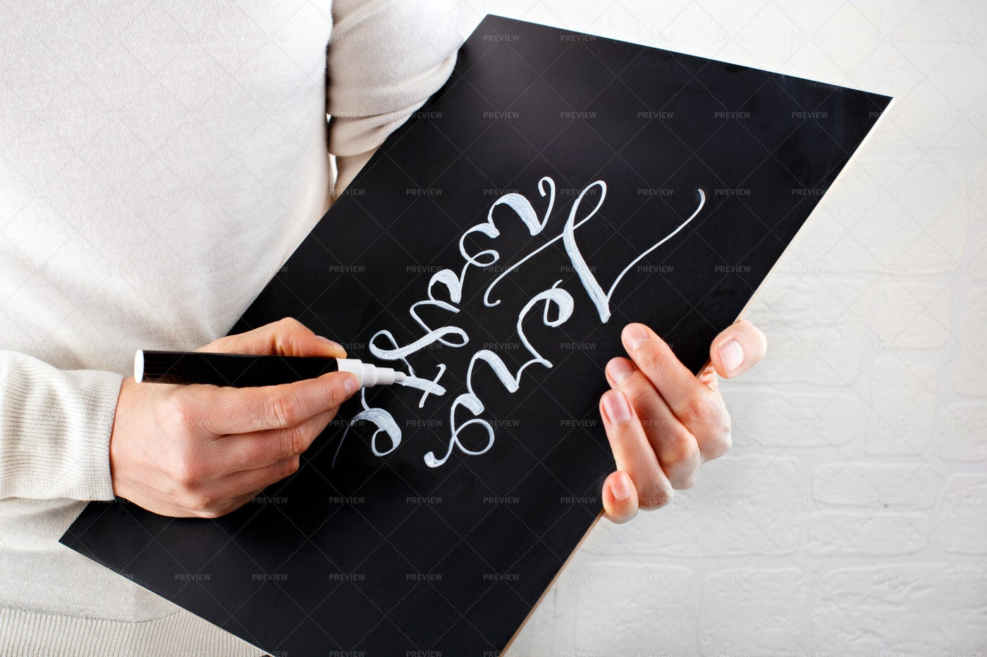 Woman Writing On Chalkboard: Stock Photos