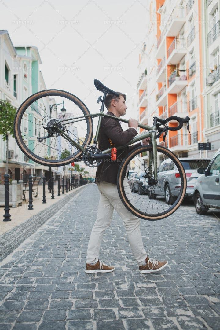 Cyclist Carrying His Bike: Stock Photos