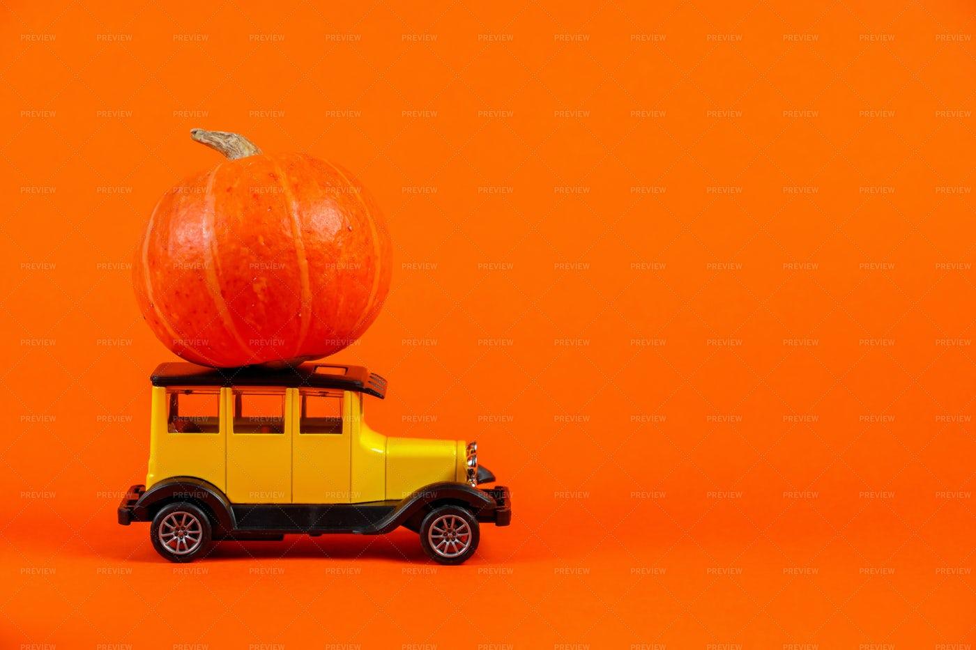 Retro Toy Car With Pumpkin: Stock Photos