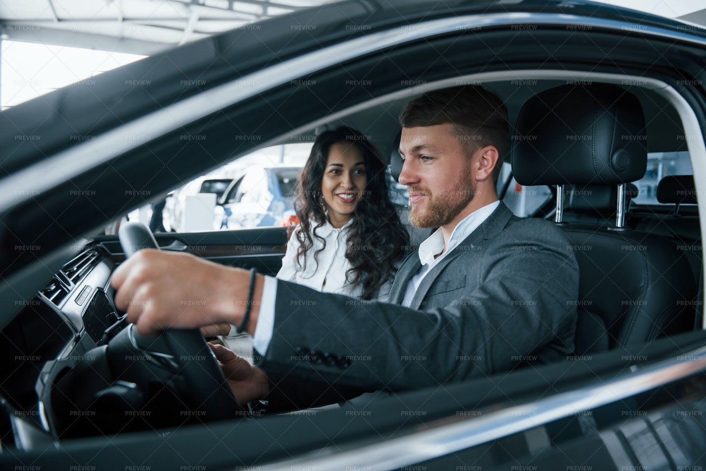 Couple Trying New Car: Stock Photos